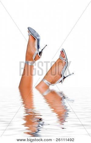 Woman legs in water on white background