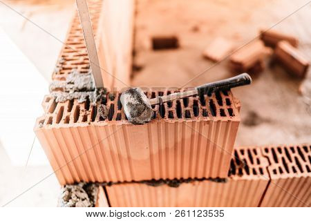 Details Of House Building, Brick Walls And Steel Infrastructure. Construction Site With Interior Wal
