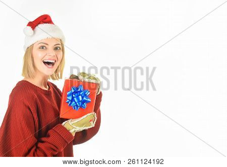 Christmas Gifts. New Year Holidays. Happy Girl In Santa Hat Holds Christmas Present. Sensual Woman I
