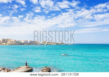 Otranto, Apulia, Italy - A Woman Standing On A Huge Stone At The Coastline Of Otranto