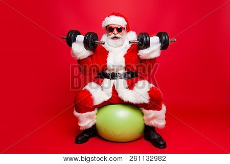 Cheerful Sporty Muscular Virile Strong Santa In White Fluffy Gloves Fur Coat Sitting On Pilates Ball