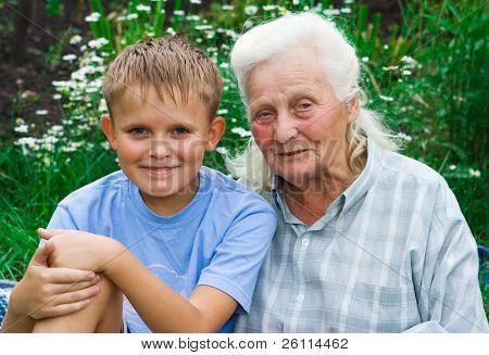 boy and grandmother in garden