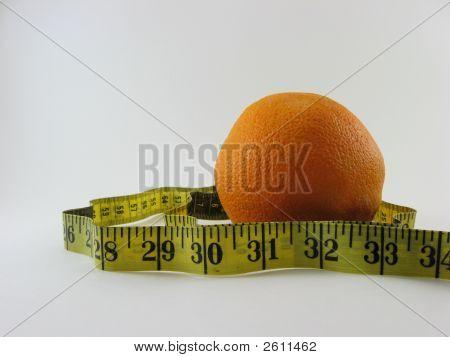 Healthy tape measure and orange