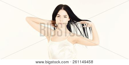 Femininity Concept. Girl On Pensive Face In Graceful Dress. Woman In Elegant White Dress With Long H