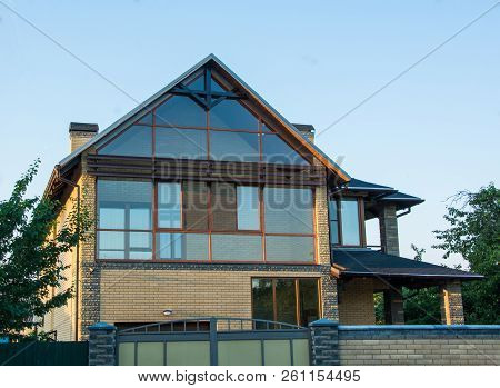 Modern House With Glazed Facade. Brick House With Panoramic Windows. Glass Wall