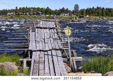 Kukkolaforsen, Sweden On June 27. View Of A Wooden Pier, River And On June 27, 2018 By Kukkolaforsen
