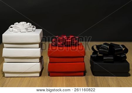 Composition Of Gift Boxes. On The Left Are Three White Boxes With A White Bow. In The Center Are Two