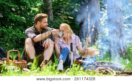 Food For Hike And Camping. Couple Sit Near Bonfire Eat Snacks And Drink. Couple In Love Camping Fore