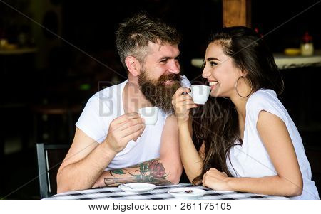 Couple in love drink black espresso coffee in cafe. Pleasant coffee break. Drinking black coffee has numerous health benefits loaded with antioxidants and nutrients. Couple enjoy hot espresso poster