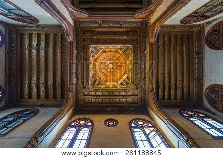 Cairo, Egypt - July 28 2018: Wooden Decorated Dome Mediating Ornate Ceiling With Floral Pattern Deco