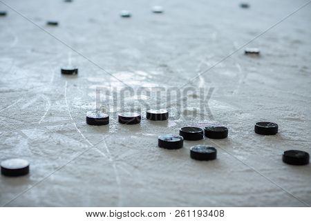 Hockey Pucks On Empty Ice Rink Nobody