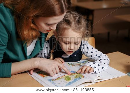 Mother Helping Kid After School. Preschooler Doing Homework With Help Of Tutor. Home Teaching Concep