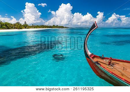 Perfect Tropical Island Paradise Beach Maldives, Clouds Over An Maldivian Island With A Boat. Wooden