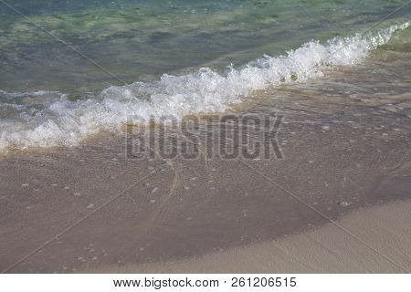 Sea Water Tide On White Sand Beach. Relaxing Sea Wave On Sand. Tropical Seaside Photo. Summer Vacati