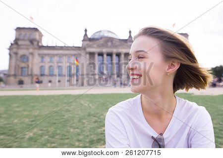 Portrait Of A Happy Smiling Girl In Berlin, Germany. Smiling Student On The Background Of European A