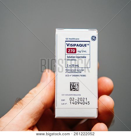 Paris, France - Oct 2, 2018: Doctor Holding Package Of Visipaque - Iodixanol Package Containing The