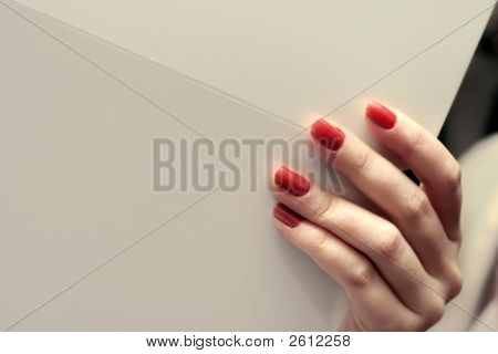 Female Hand Holding Whitepaper