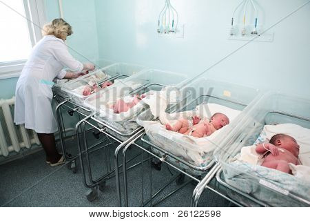 newborn in childbearing center and doctor