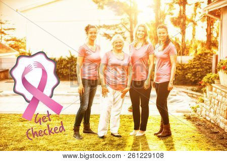Breast cancer awareness ribbons with get checked text against women standing up to breast cancer