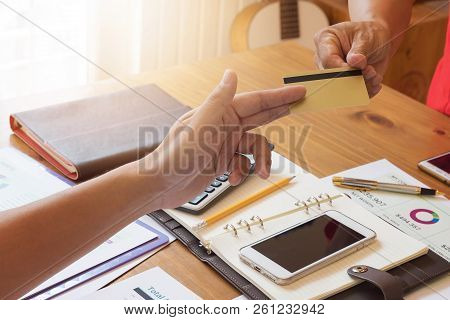 Businessman Sending Credit Card To His Partner.