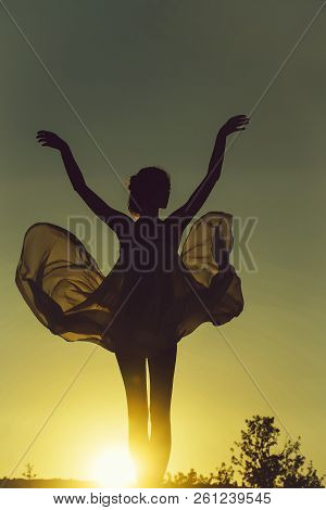 Silhouette Of Slim Girl Young Woman Female Model Dances In Transparent Windy Dress On Nature Over Be