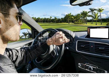 Male Hands Holding Car Steering Wheel. Hands On Steering Wheel Of A Car Driving. Young Man Driving A
