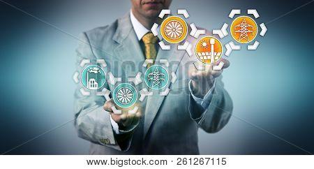 Businessman Raising Electric Power Generation Via Concentrating Solar Power Above Electricity Genera