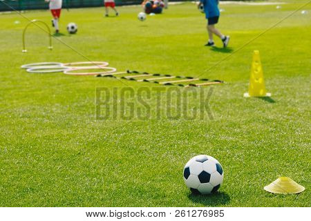 Physical Education Class. Soccer Training Session On The Grass Sports Field. Football Training Equip