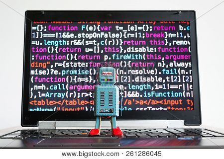 Robot With Source Code Screen, Artificial Intelligence, Deep Learning Concept