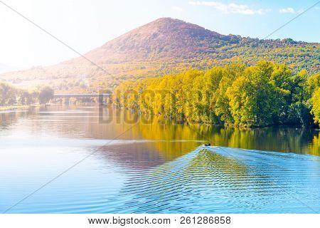 Radobyl Mountain In Ceske Stredohori, Central Bohemian Uplands. View From Labe River In Litomerice,
