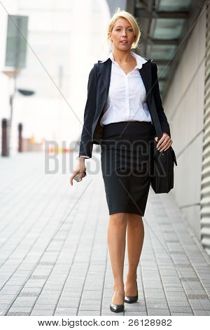 Young Businesswoman Walking