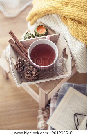 Knitted, Warm Sweaters, A Cup Of Hot Tea, Autumn Decor, A Book, A Pumpkin On A Wooden Chair. Cozy, A