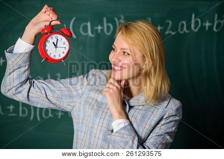 Woman Teacher Hold Alarm Clock. Girl School Lecturer. What Time Is It. Lessons Schedule. Welcome Tea