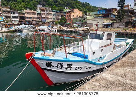 Keelung, Taiwan - September 5, 2018: White Wooden Fishing Boat Moored In Old Fishing Harbor Of Keelu