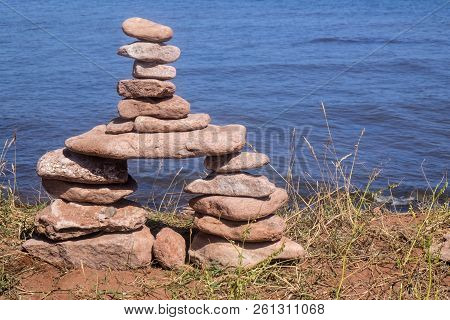 Inukshuk Standing Near The Shore In North Cape Prince Edward Island