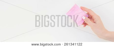 Woman Hand With Pastel Manicure Polish Holding Pink Daily Sanitary Napkin Isolated On White Backgrou