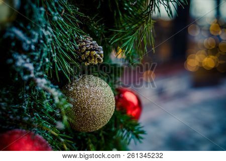 Christmas Family Atmosphere.red, Golden Christmas Ornament Hanging On A Frost Covered Pine Tree Outd