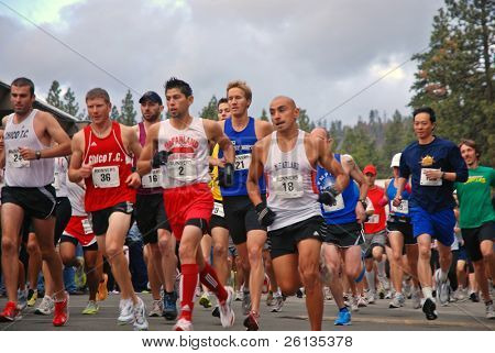 SOUTH LAKE TAHOE, CA - JUNE 14: Runners at the starting line take off after gun fires DeCelle Memorial Lake Tahoe Relay race June 14, 2009 at South Lake Tahoe, California