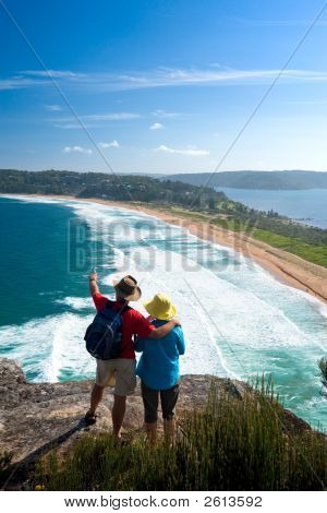 Two People Enjoy A Spectacular View