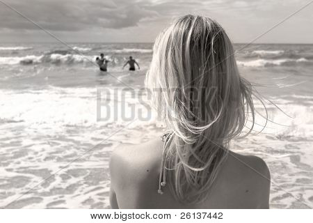 girl looking in the stormy sea