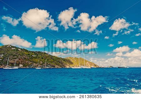 Green Mountain With Yacht, Boat, Ship Transportation In Bay Or Harbor With Sea, Ocean Water And Blue