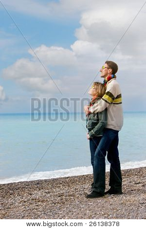loving couple on beach looking up
