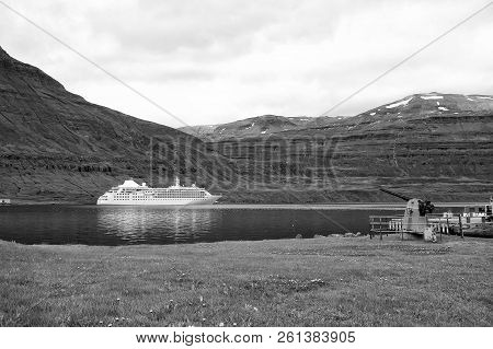 Cruise Ship In Fjord Of Sejdisfjordur, Iceland. Ocean Liner In Sea Harbor On Mountain Landscape. Cru
