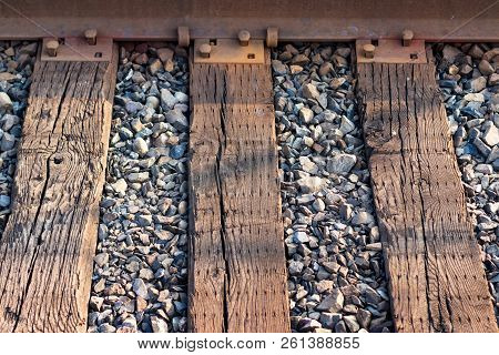Railroad Ties And Steel Track Abstract With Crushed Rock