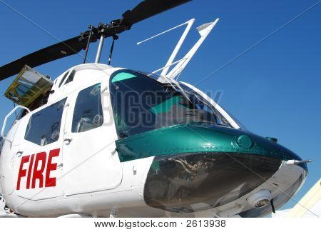 Front closeup view of fire fighter helicopter poster