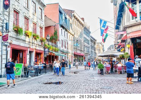 Montreal, Canada - Aug 20, 2012: People Meander At The Junction Of Rue Saint-paul And Rue Saint-vinc