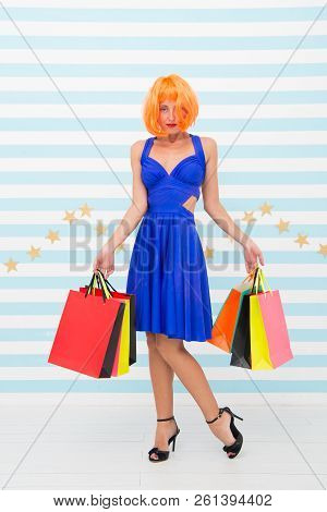 Shopping. Attractive Girl Is Crazy About Shopping. Delighted Woman Shopping Online. Woman Going To M