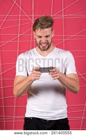 Excited About Gaming. Guy Play Game Smartphone Gadget. Gamer Aggressive Face Play Online Game Smartp