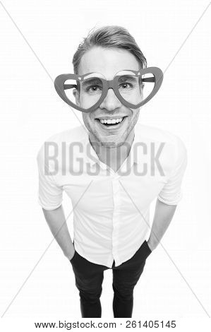 In love glance. Man happy smiling blond eyes in heart shaped eyeglasses fall in love. Perfect boyfriend fall in love. Man handsome attractive looks lovely and sweet isolated white background. poster