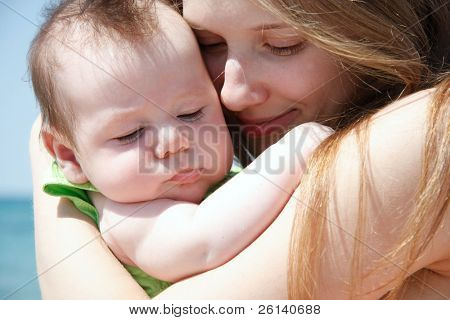 close up portrait of mother and baby on nature